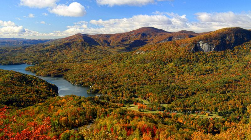 Rumbling Bald (cliff face to the right) in the Hickory Nut Gorge. (Photo courtesy VisitNC.com)