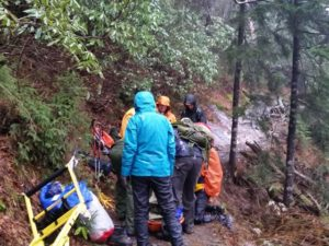 Rescuers get ready for the long descent down the mountain.